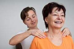 Senior woman receiving massage Royalty Free Stock Photography