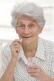 Senior woman receiving medication Stock Photo