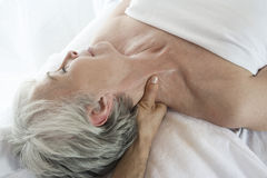 Senior Woman Receiving Neck Massage At Spa Royalty Free Stock Photography