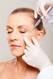 Senior woman cosmetic injection Stock Photography