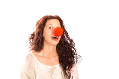 Senior woman with red clown nose Stock Photo