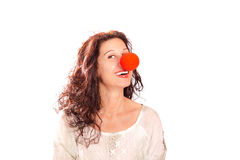 Senior woman with red clown nose Royalty Free Stock Photos