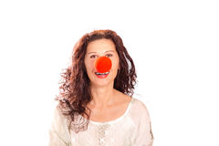 Senior woman with red clown nose Stock Image
