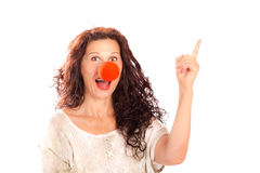Senior woman with red clown nose Stock Photos