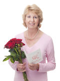Senior woman with red roses and Valentine card Royalty Free Stock Photos