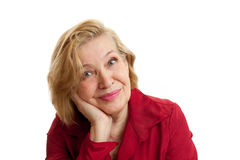 Senior Woman in red smiling on white background. Blond hair. Shot in studio Stock Photos