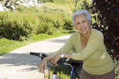 Senior woman relaxing. Active senior woman relaxing after riding her bike Stock Photos