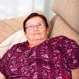 Senior woman relaxing. Close up of elderly woman relaxing on sofa Stock Photos
