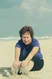 Senior woman relaxing on the beach Stock Photos
