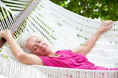 Senior Woman Relaxing In Beach Hammock Royalty Free Stock Image