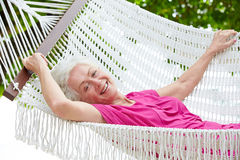 Senior Woman Relaxing In Beach Hammock Royalty Free Stock Photo