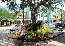 Senior woman relaxing on bench in South FL Stock Image