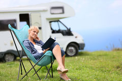 Senior woman relaxing in camping chair Royalty Free Stock Image