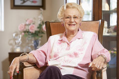 Senior woman relaxing in chair Stock Photo