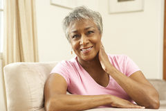Senior Woman Relaxing In Chair At Home Royalty Free Stock Photography