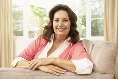 Senior Woman Relaxing In Chair At Home Royalty Free Stock Images