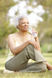Senior Woman Relaxing After Exercise Royalty Free Stock Photography