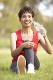 Senior Woman Relaxing After Exercise Stock Images