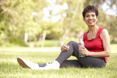 Senior Woman Relaxing After Exercise Royalty Free Stock Photos