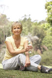 Senior Woman Relaxing After Exercise Royalty Free Stock Images