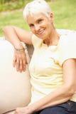 Senior Woman Relaxing In Garden Stock Photos