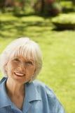 Senior Woman Relaxing In Garden Royalty Free Stock Photo