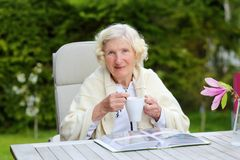Senior woman relaxing in the garden Stock Photos
