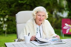Senior woman relaxing in the garden Stock Images