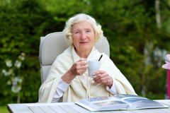 Senior woman relaxing in the garden Royalty Free Stock Image