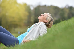 Senior woman relaxing in grass Royalty Free Stock Photo