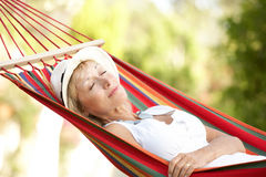 Senior Woman Relaxing In Hammock Stock Photos