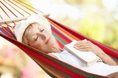 Senior Woman Relaxing In Hammock royalty free stock photos