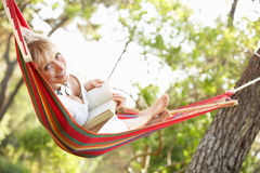 Senior Woman Relaxing In Hammock Royalty Free Stock Images