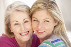 Senior Woman Relaxing At Home With Adult Daughter Stock Photo