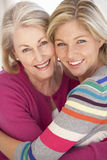 Senior Woman Relaxing At Home With Adult Daughter Stock Photos