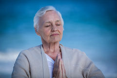 Senior woman relaxing with joined hands Royalty Free Stock Photos