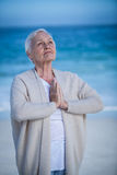 Senior woman relaxing with joined hands Royalty Free Stock Images