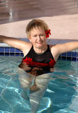 Senior woman relaxing in the pool Stock Photography