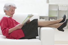 Senior woman relaxing in reading royalty free stock photography