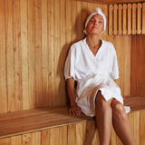 Senior woman relaxing in sauna Stock Images