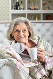 Senior woman relaxing. On sofa at home Stock Photography