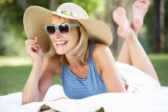 Senior Woman Relaxing In Summer Garden Stock Photography