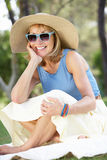Senior Woman Relaxing In Summer Garden Royalty Free Stock Photo
