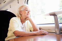 Senior Woman Relaxing On Train Journey Royalty Free Stock Images