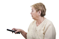 Senior woman with remote control Royalty Free Stock Images