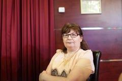 Senior woman in restaurant Stock Photo
