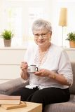 Senior woman resting on sofa Stock Photo