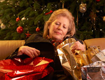 Senior Woman Returning After Christmas Shopp Stock Photography