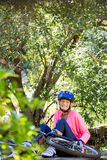 Senior woman is rhurting because of her bike Stock Images