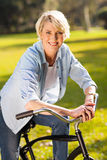 Senior woman riding bike Stock Images